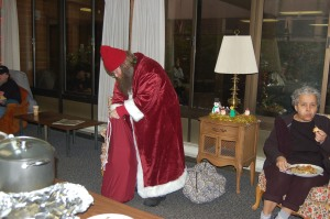 Santa passing out gifts.