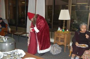 Santa passing out gifts.