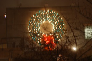 Wreath outside of ice rink. You can kind of see the fog.